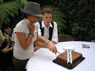 Cutting their first cake